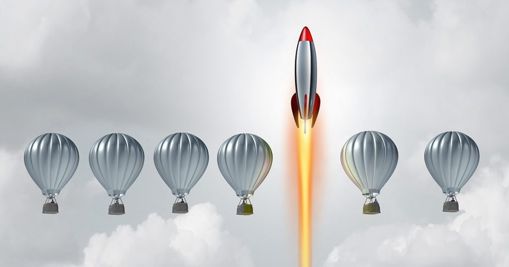 Rocket ship soaring past hot air balloons
